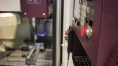 Control Panel CNC.  Machine milling  steel part on background - stock footage