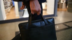 Man walking with business bag, slowmotion footage Stock Footage