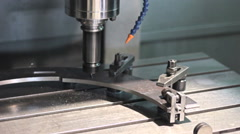 Close-up CNC  Machine milling drilling steel part - stock footage