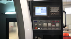 Control Panel CNC.  Machine milling, drilling  steel part. Panoramic Stock Footage