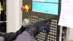 Industrial Worker. CNC Machining operator. Male worker industrial control panel Stock Footage