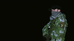 Man in a cap and in the military uniform aiming his handgun - stock footage