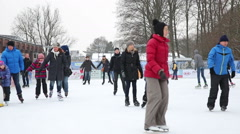Skaters on outdoor ice rink Stock Footage