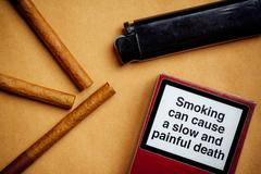 Smoking cigarettes addiction and health issue concept, flat lay arrangement Stock Photos