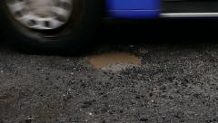 Pothole in the street Stock Footage