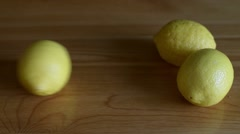 Lemon rolling down a table Stock Footage