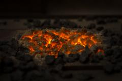 Glowing charcoal with dark background Stock Photos