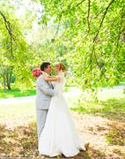 Bride and groom having a romantic moment on their wedding day - stock photo