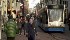 Busy city street in Amsterdam and trolley Stock Footage