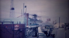 1955: Personal amphibious helicopter taking off from land platform. Stock Footage