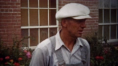 Stock Video Footage of 1940: Overalls man talking to fedora hat formal fashion dude.