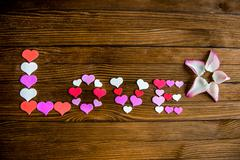 Word Love from the hearts on a wooden background. - stock photo