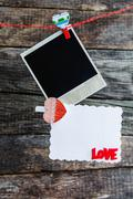 one polaroid photo frames and heart for valentine's day - stock photo