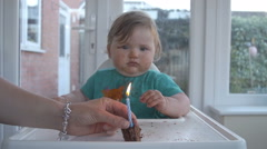 Little Baby Enjoys Her First Birthday Cake Stock Footage