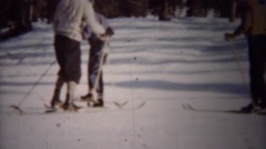 1940: Winter snow skiing T-bar chairlift ride up mountain. Stock Footage