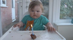 First Candle On Babies First Birthday Cake Stock Footage