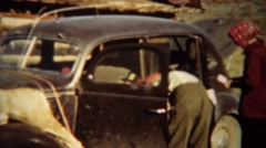 1939: Two dead whitetail deer tied down to Lincoln car hood for transport. - stock footage