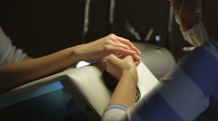Manicure process in beauty salon showing filling and polishing of nails Stock Footage