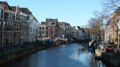 View of a houses near the canal, Leiden, Netherlands Stock Footage