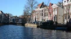 Houses near the water in Leiden, South Holland Stock Footage