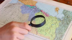 A person is studying map of Syria Stock Footage