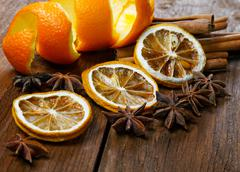 Dried peel of an orange and spice on a table Stock Photos