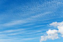 Stratocumulus clouds and the dark blue sky Stock Photos