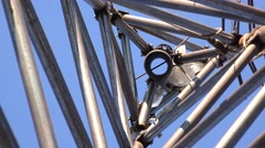 Zooming of Steel Triangle Tower for Wind Turbine.  Look from the bottom. 4K Ultr Stock Footage