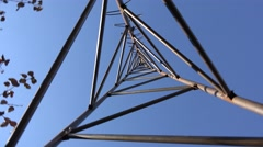 Rotating of Steel Triangle Tower for Wind Turbine.  Look from the bottom. 4K Ult Stock Footage
