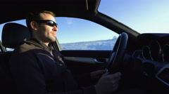 Portrait of handsome man in car in winter Stock Footage