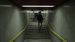 A young man goes in the underpass, modern interior - stock footage