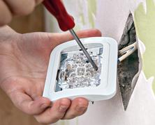 Repair of home wiring, installing a new light switch, close-up. - stock photo