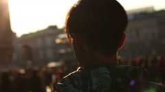 A young man walking down the street, sunny day. Milan, Italy. Steadicam shot - stock footage
