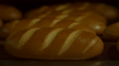Bread in the furnace. Output bread from the oven. - stock footage