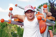 Child workout on exercise equipment Stock Photos