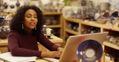 Portrait of a young entrepreneur working in her ceramics store. Slow motion. Stock Footage