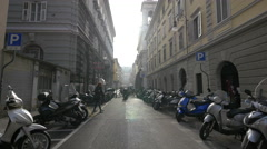 Motorcycles parked on a street in Trieste Stock Footage
