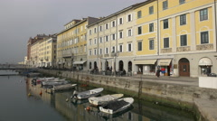 Canal Grande with old buildings and boats in Trieste - stock footage