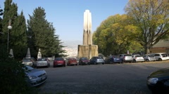 Cars parked near Parco della Rimembranza fountain in Trieste Stock Footage