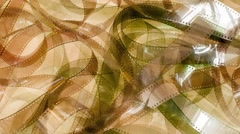 Abstract brown unrolled movie film strip rotation - stock footage