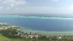 AERIAL: Flying over the mountain revealing beautiful islands with luxury resorts Stock Footage