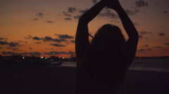 Girl silhouette dancing at sunset Stock Footage