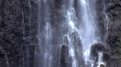 CLOSE UP: Waterfall splashing down the rocky wall Stock Footage