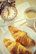 Continental Breakfast Croissant, Coffee & Alarm Clock - stock photo