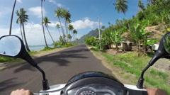 FPV: Riding motor bike on sunny Bora Bora island resort Stock Footage