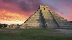 Mayan ruins chichen itza castillo at sunset Stock Footage