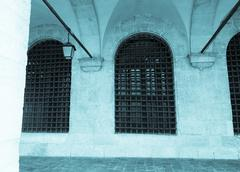 venezian windows on building - stock photo