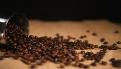 Coffee Beans Falling on Bagging from Cezve Stock Footage