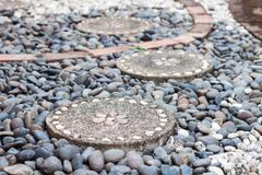 Garden stone path with pebble stone - stock photo