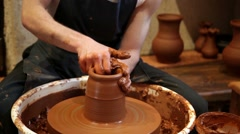 Potter working with clay in pottery - stock footage